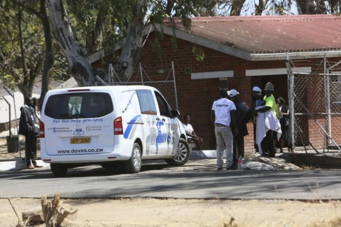 A van from a funeral parlor enters former President Robert Mugabe's rural home in Zvimba, about 100 kilometers north west of the capital Harare, Saturday, Sept. 28, 2019. According to a family spokesperson Mugabe is expected to be buried at the residence after weeks of drama mystery and contention over his burial place. (AP Photo/Tsvangirayi Mukwazhi)