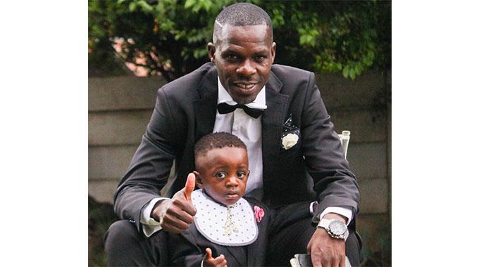 Tapuwa Kapini with his son Michael.