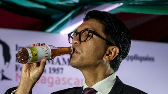 President Andry Rajoelina took a sip at the launch of Covid-Organics [Henitsoa Rafalia/Anadolu]