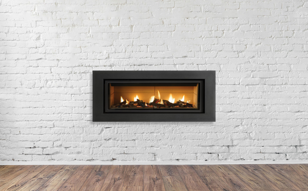 gas fireplace installed in white brick wall
