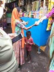 Giving candy to a mother for her children