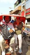 Riding in rickshaws on the way to the guided tour