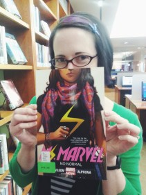 Amy Galante, a librarian at Bentley, holds up one of her favorite graphic novels. (Photo by Catherine Monroy)