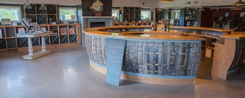 Black Star Farms Old Mission houses a tasting room with a round bar crafted from barrels.