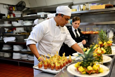 Chef Antopia creates appetizers for the themed Spanish dinner. Photo by Hilary Nichols.