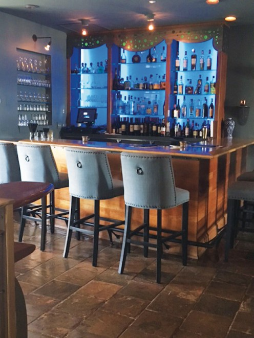 Stop in and enjoy a drink at the beautiful bar.