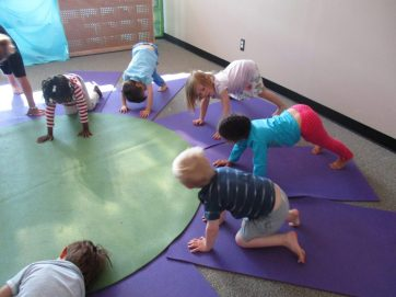 Never too early to say Namaste: 3-year-olds at Grosse Pointe Public School System Preschool limber up in yoga class.