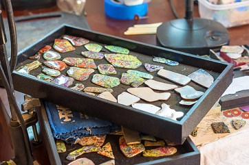 Trays of graffiti ready for transformation into jewelry.