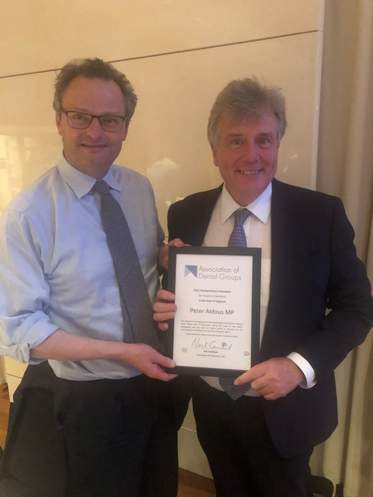 Dental Review News: Neil Presents Peter Aldous MP with the ADG Parliamentary Champion Award