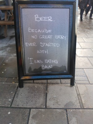 Beer advert alleging no story ever started with 'I was eating salad'