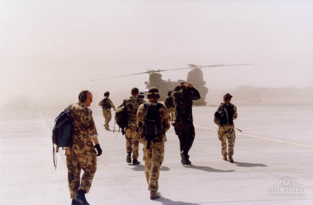 Lancashire Wedding Photographer - Military personnel boarding a Chinook helicopter in Oman.