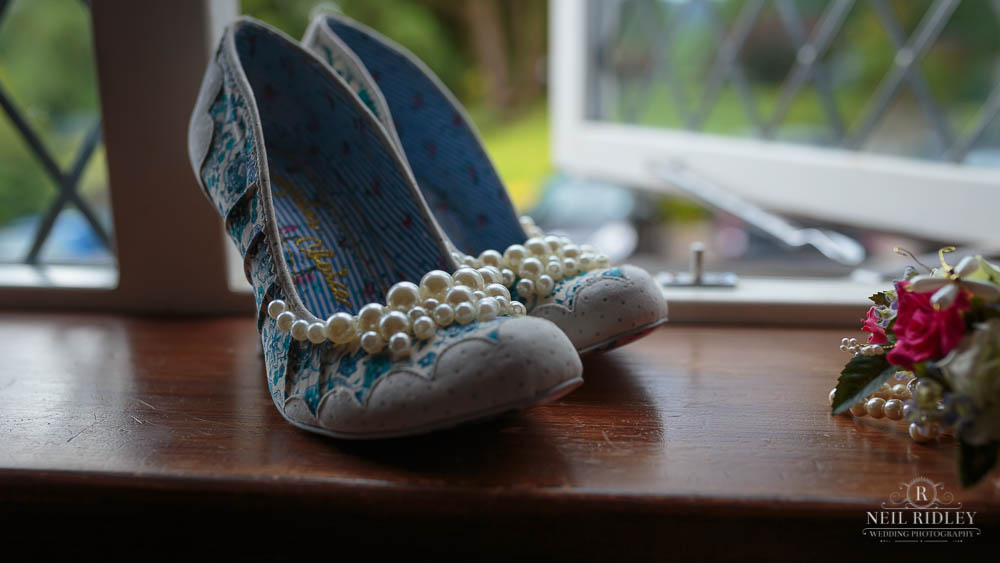 Brides Irregular Choice shoes on a windowledge at Broadoaks Country Hotel Lake District