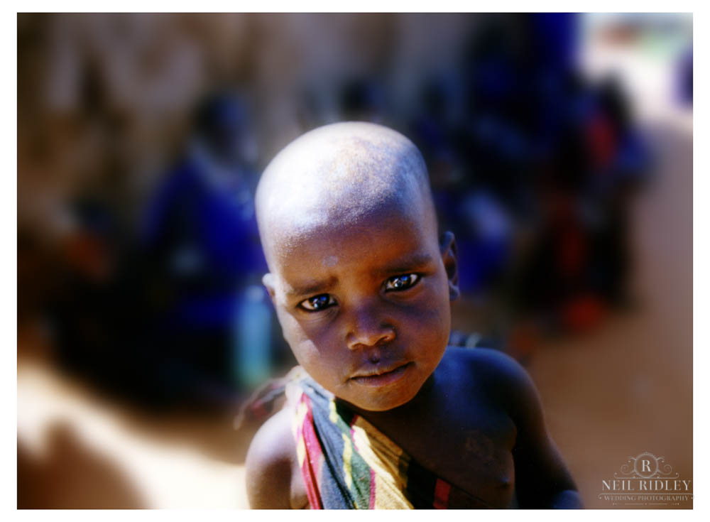 Lancashire Wedding Photographer - A Massai child looks into the camera lens in Kenya.