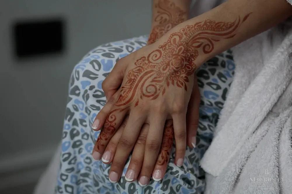 Muslim Bride with Henna on her hands.