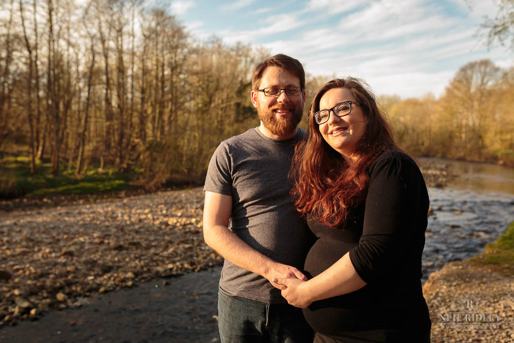 Lancashire Pre Wedding Shoot at Scorton Lake, a young couple hold hands by the river