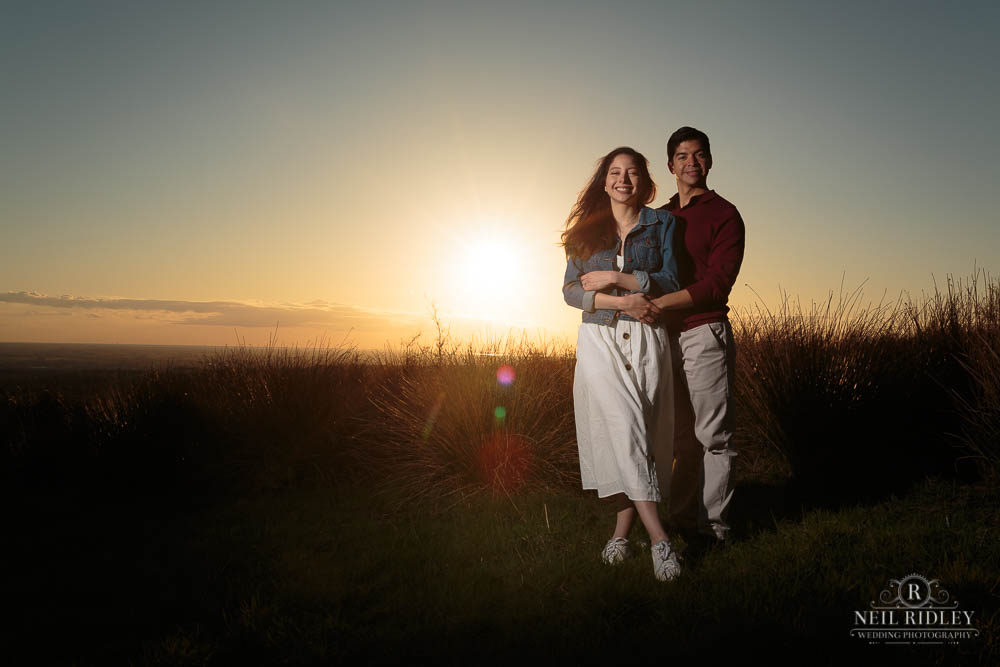 Lancashire Pre Wedding Shoot Couple pose in front of a Fylde Coast Sunset