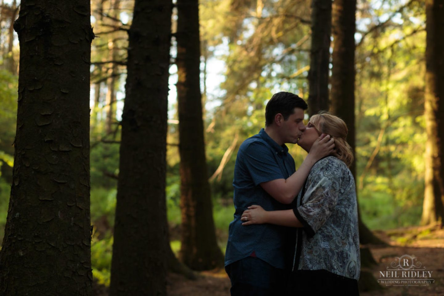 Lancashire Pre Wedding Shoot at Beacon Fell, Young couple kiss in a forest