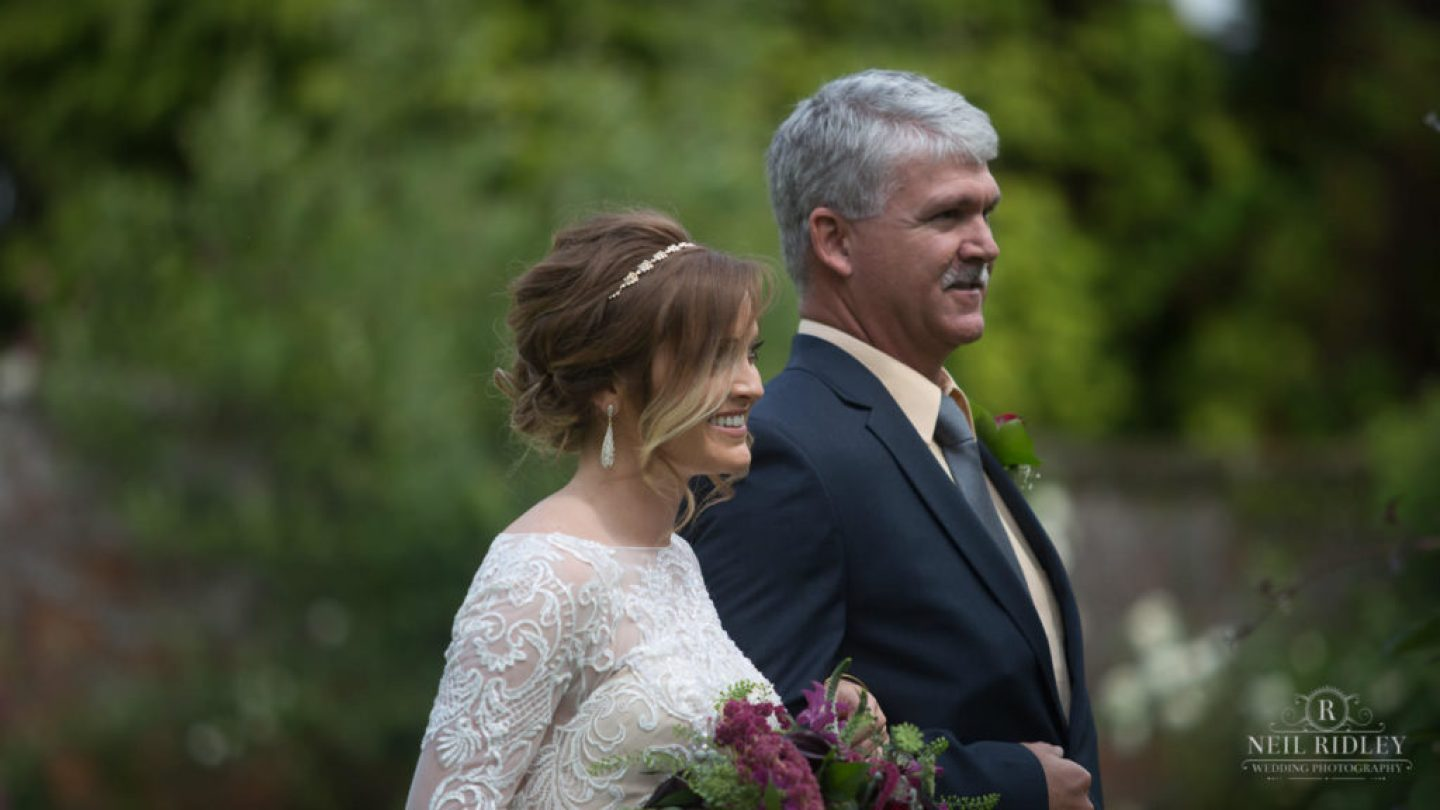 Albright Hussey Wedding Photographer, Father of the bride walks his daughter down the aisle at Albright Hussey Manor