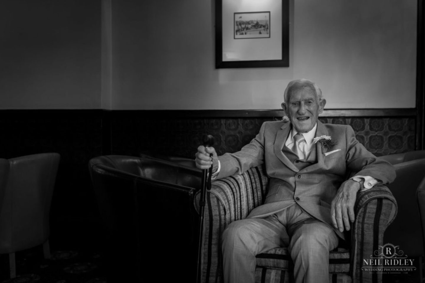 Black and white image of brides father sat in a chair at The Park House Hotel in Blackpool