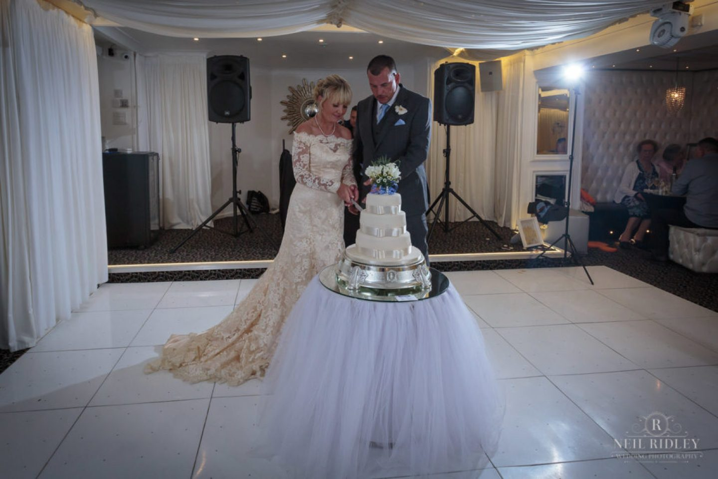 Bride and Groom cut the cake on the dance floor at The Park House Hotel, Blackpool