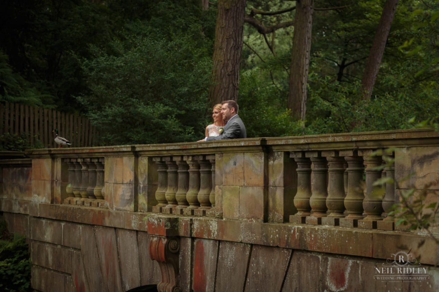 Lancaster Wedding Photographer - Bride and Groom on bridge at Williamson Park, Lancaster