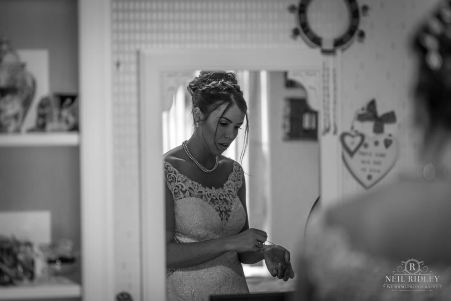 Black and white image of Brides refection in wardrobe mirror