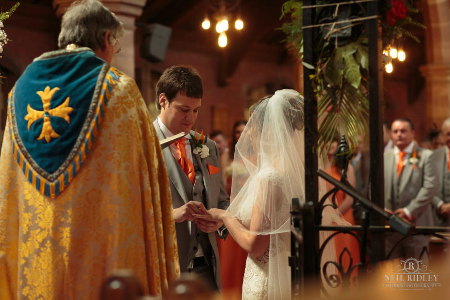 Bride and Groom exchange rings St Thomas Church in St Annes-on-Sea