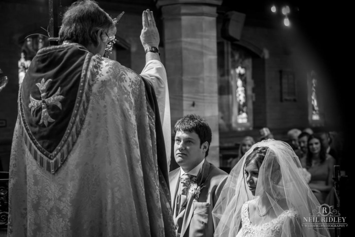 Bride and groom at the Altar St Thomas Church in St Annes-on-Sea