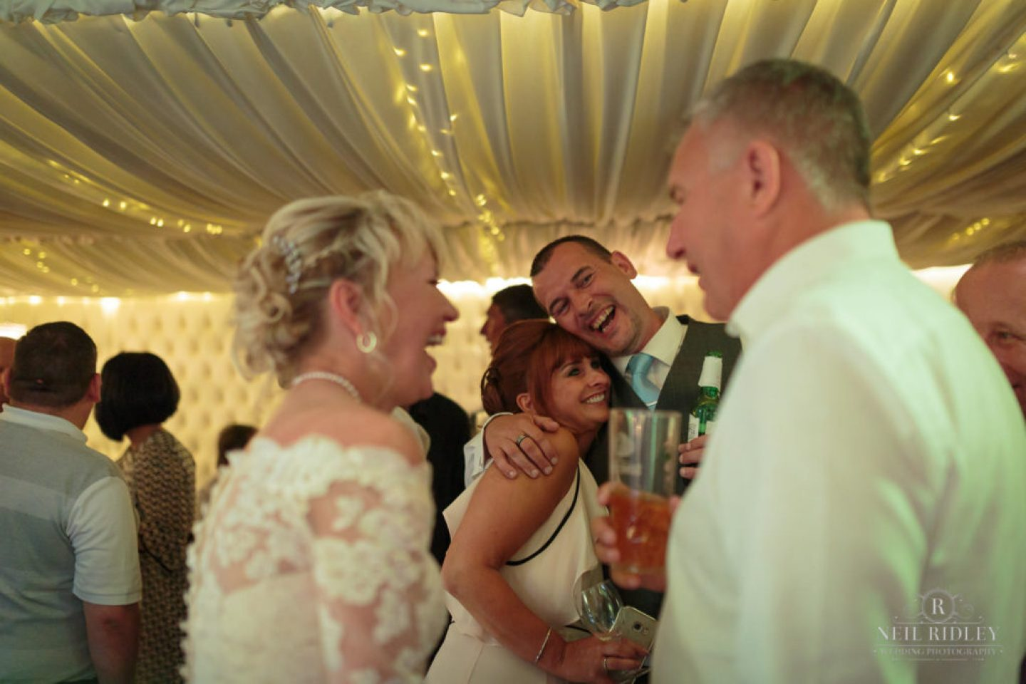 Groom hugs a wedding guest at The Park House Hotel, Blackpool