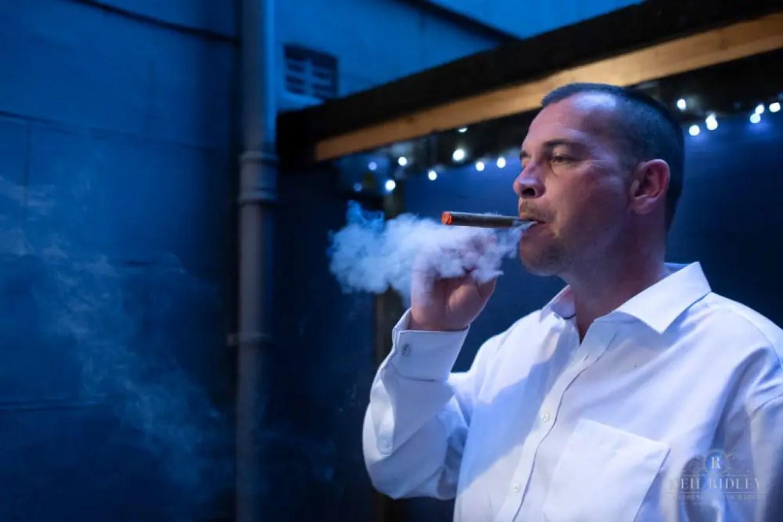 Groom smokes cigar at The Park House Hotel, Blackpool