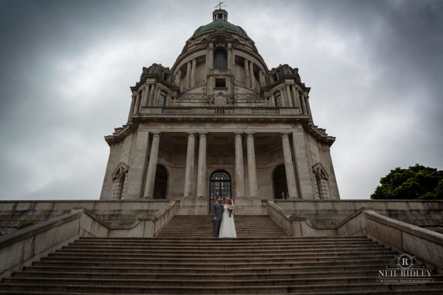 Lancaster Wedding Photographer - Bride and Groom pose on the steps at Ashton Memorial Lancaster