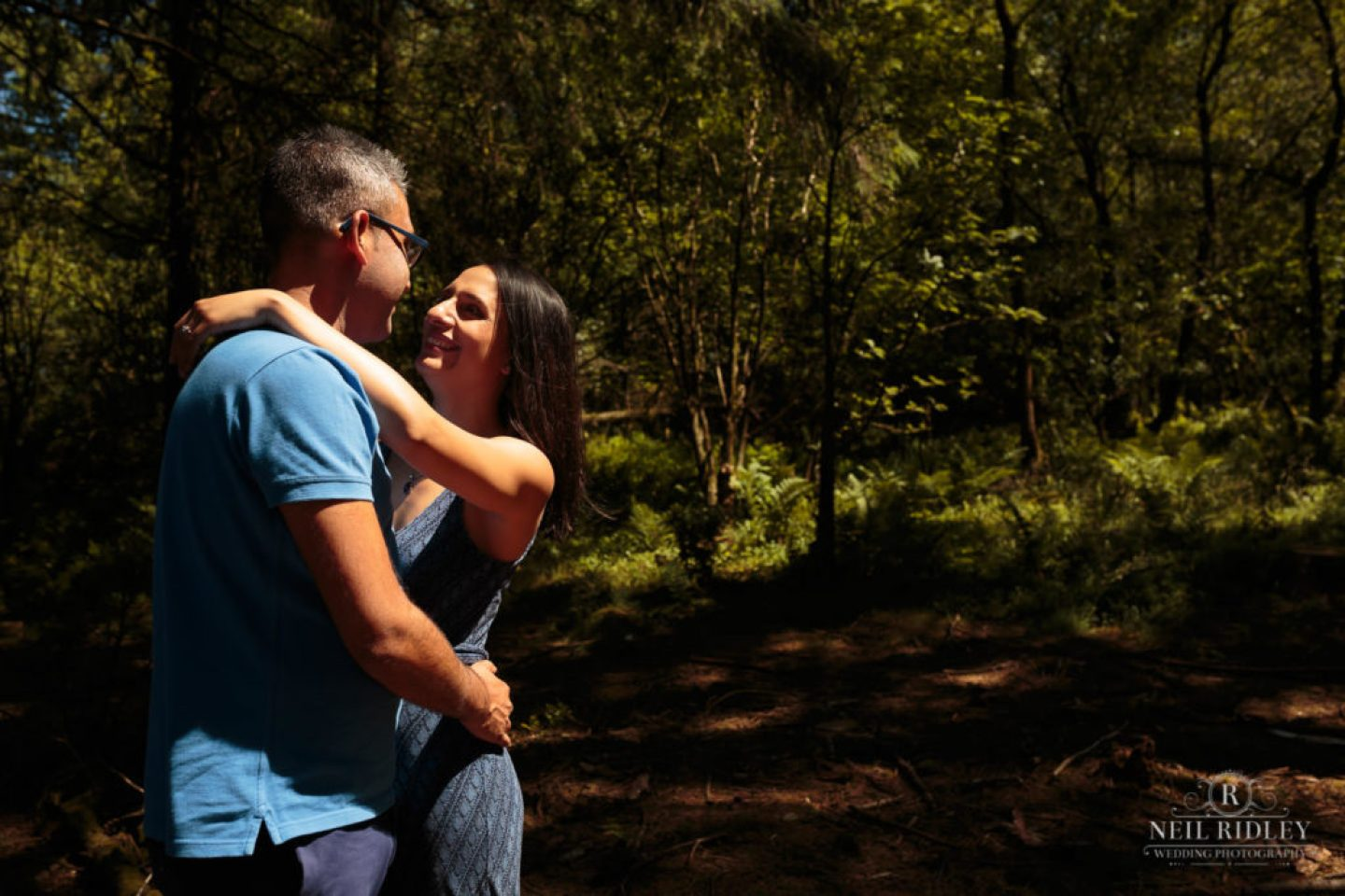 Engagement Shoot Couple face to face in the forest at Beacon Fell Lancashire