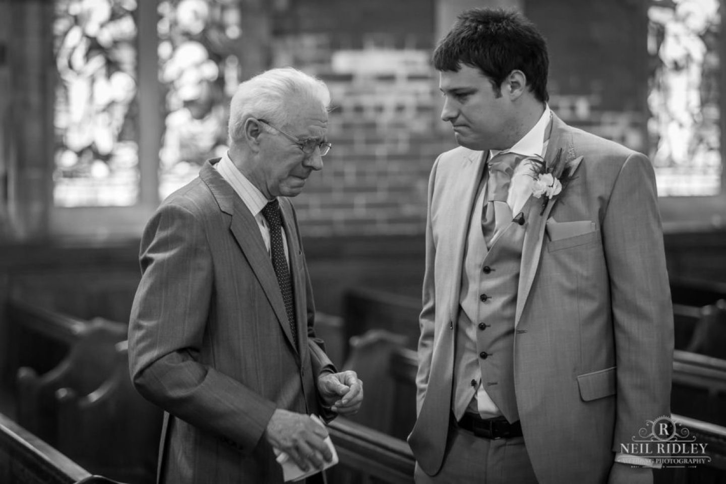 Black and white image of Groom in the church with his Granddad at St Thomas Church in St Annes-on-Sea