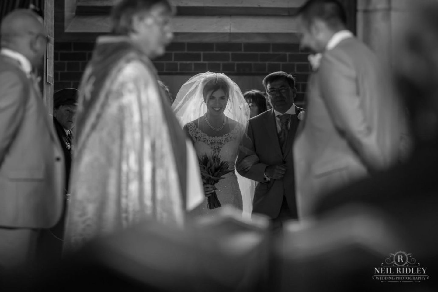Black and white image of Bride and her Father entering the church at St Thomas Church in St Annes-on-Sea