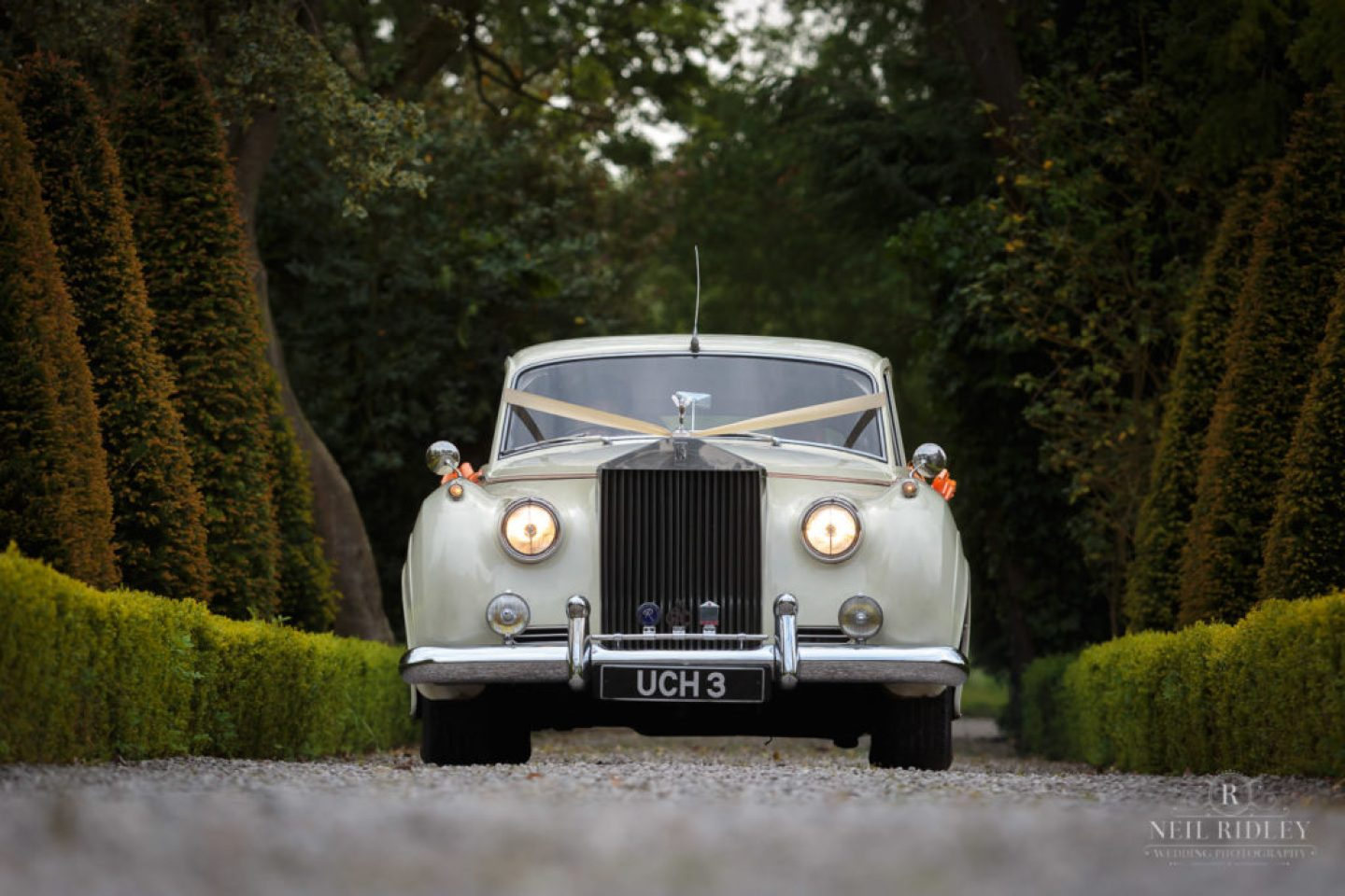 Cloud cars wedding car arriving at The Great Hall at Mains