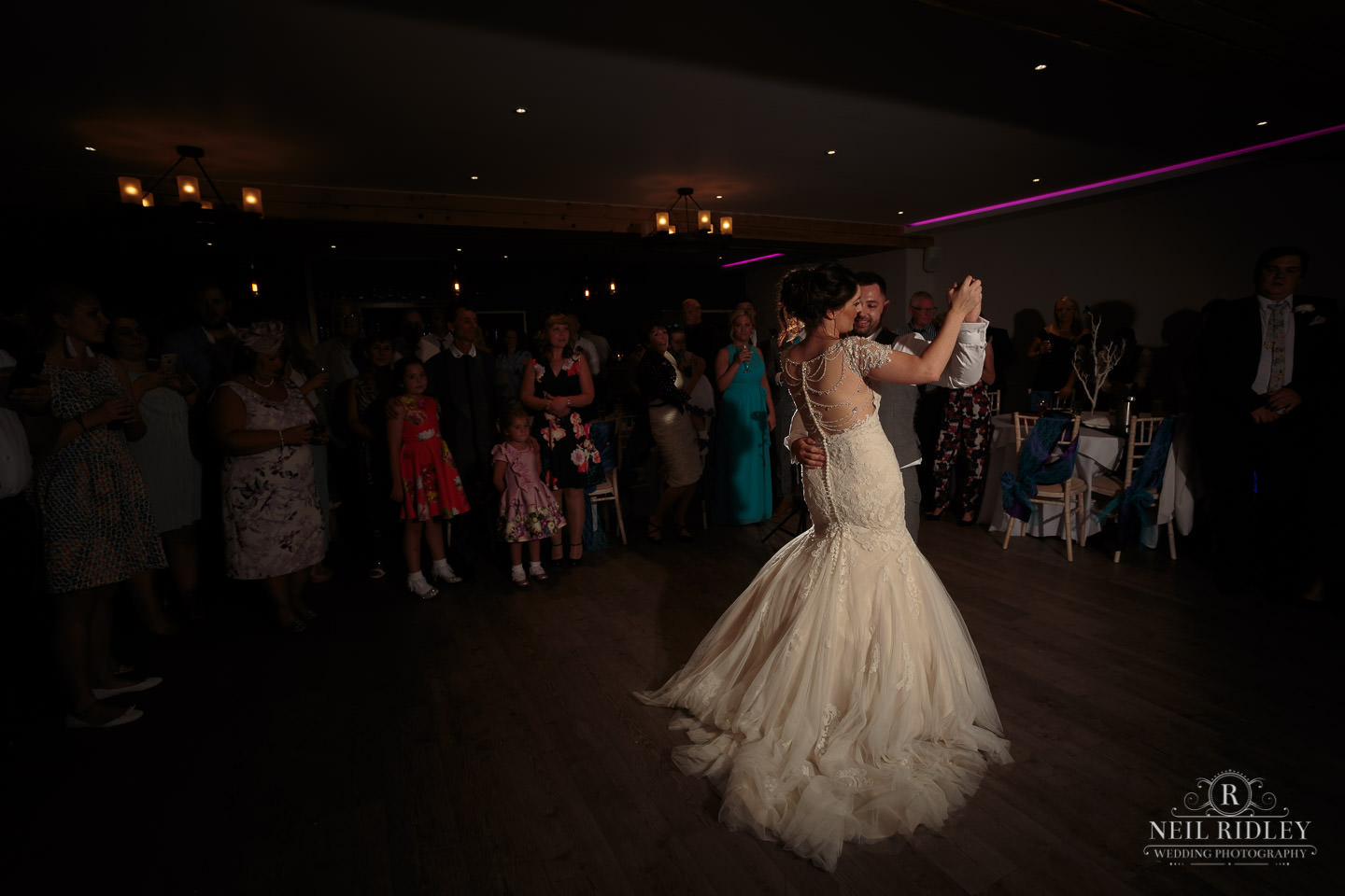 Bride and Groom enjoy their first dance on the dance floor at The Mill at Conder Green