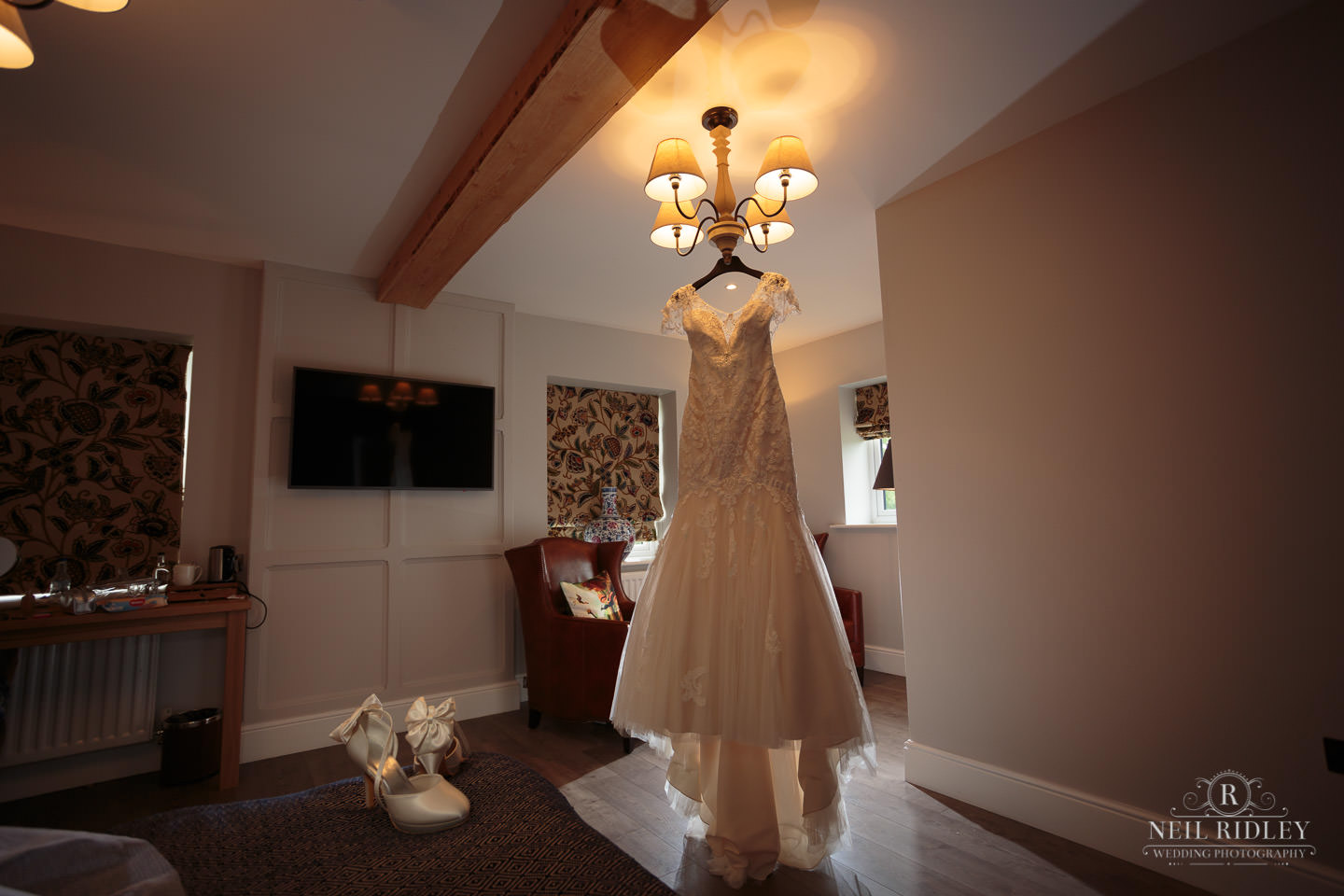 Wedding Dress hung up in the Bridal Suite during Bridal Prep at The Mill at Conder Green
