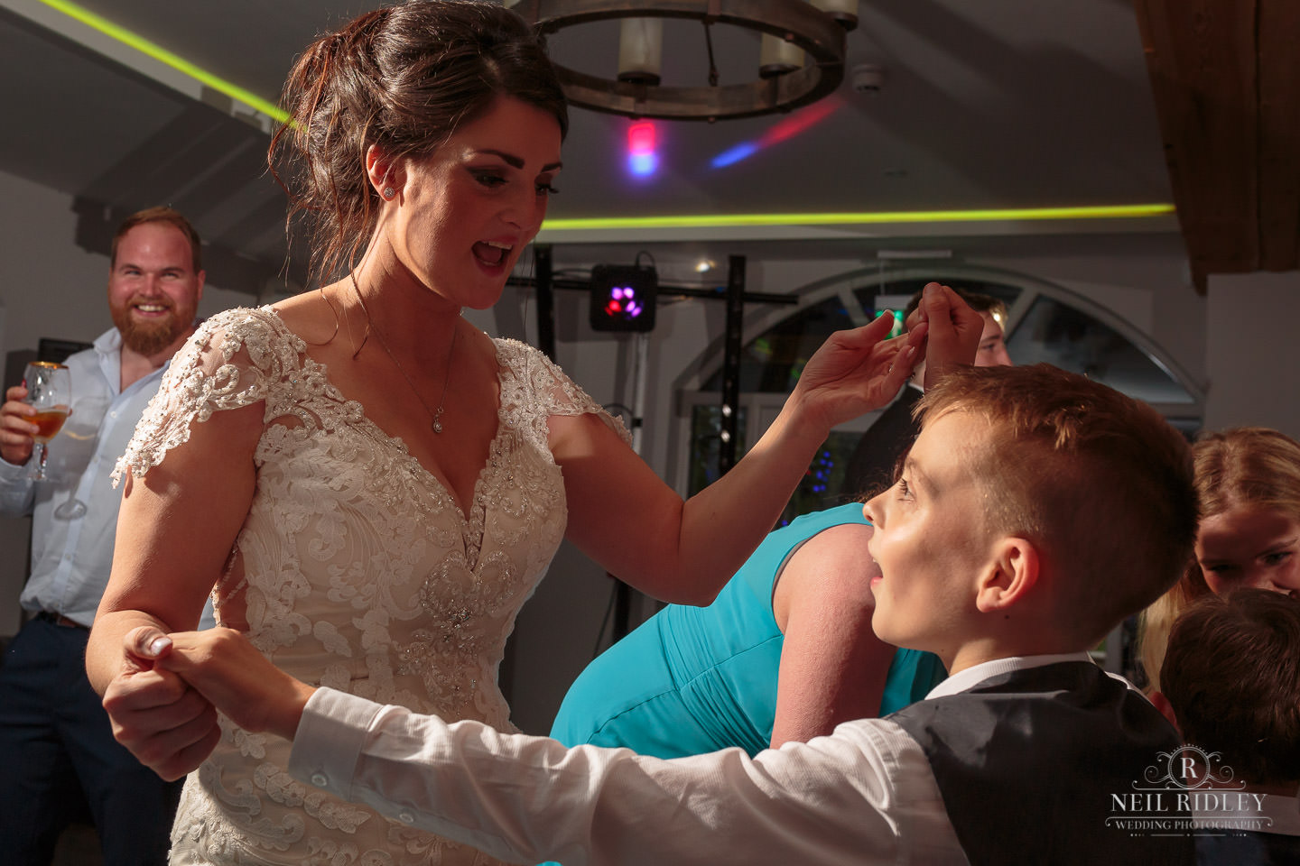 Bride dances with her young son at The Mill at Conder Green