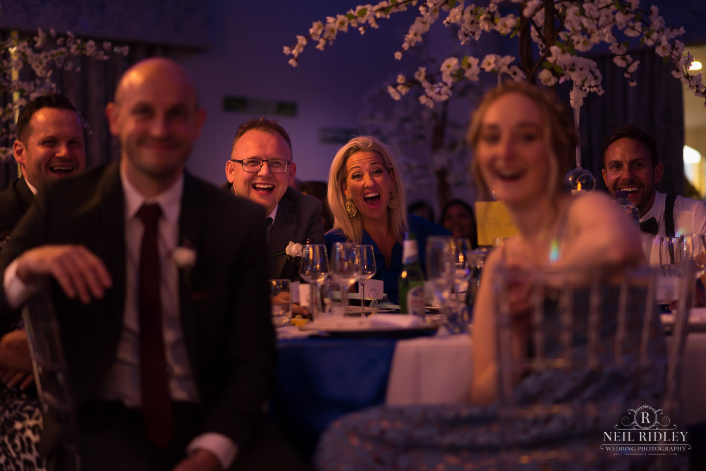 Merrydale Manor Wedding Photographer - Wedding guests laugh during speeches
