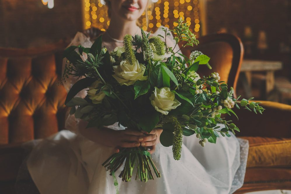 bridal bouquet, green and white florals roses and foliage at Waxham Barn, Norfolk