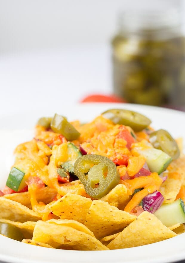 Lynne's nachos with spicy salsa is a healthier version of the delicious Mexican sharing snack without the calorific content. Simple and made from fresh and low cost ingredients, this alternative nachos with spicy salsa is great to enjoy with friends!