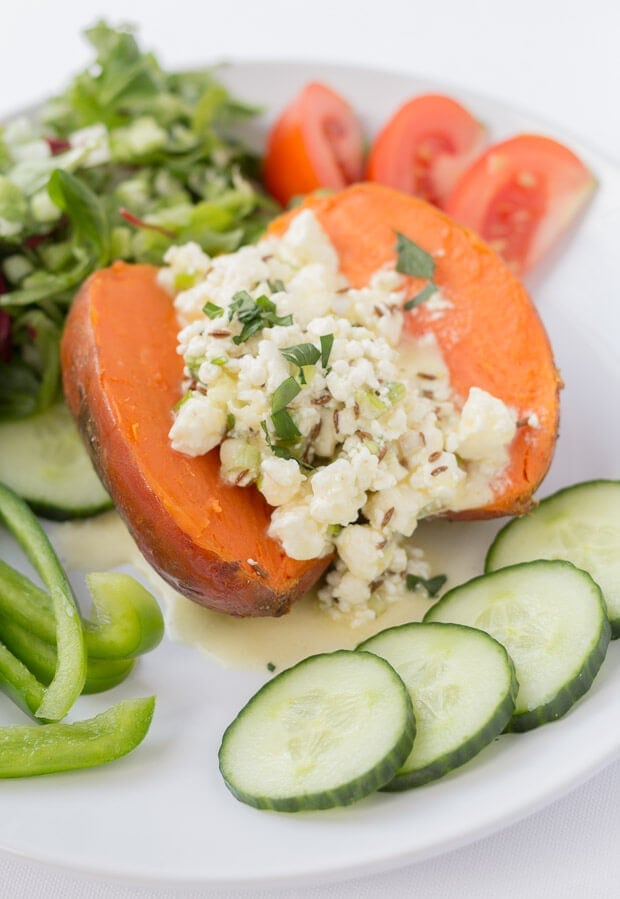 Baked sweet potato with feta and orange is a delicious quick healthy meal. The feta and orange filling compliments the baked sweet potato so well. Great served with a simple bistro salad!