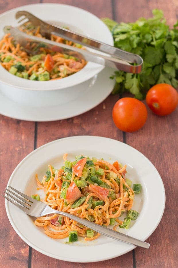 Spiralized sweet potato salad is a simple salad made with a healthier dressing compared to other salad dressing options. It's easy to make, a great way to use up leftovers and can be served as a main course or as a side!