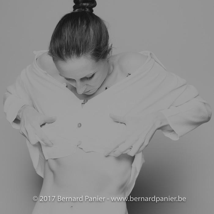 black white bun woman white shirt