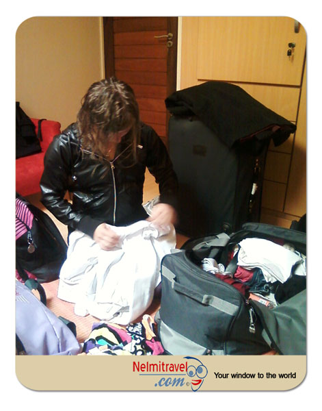 pack suitcase well;suitcase packing tips and tricks pack suitcase so clothes don`t wrinkle;efficient suitcase packing