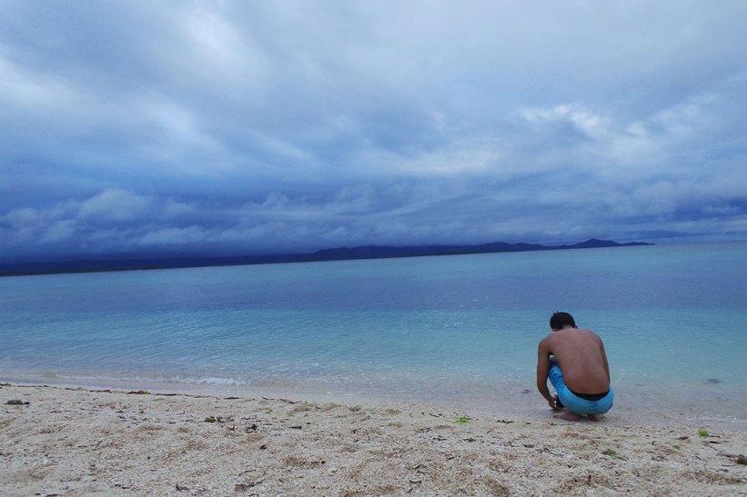 Blue waters of Maniwaya Island