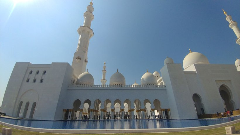 Minarets, columns, and reflecting pool