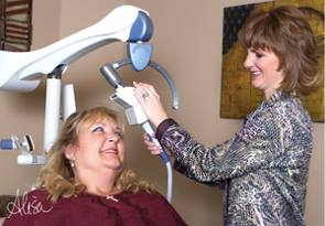 N&C web design project for TMS Serenity Center in Sugar Land, TX. This is photo of the owner using the TMS device