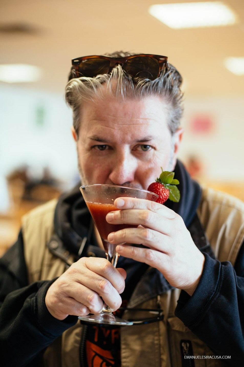 A guest at the professional school in Fundao sips a freshly prepared cherry and strawberry cocktail made by a teacher, Fundao, 2016
