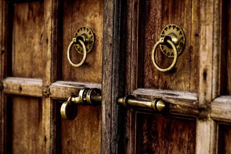 brown wooden door with locks